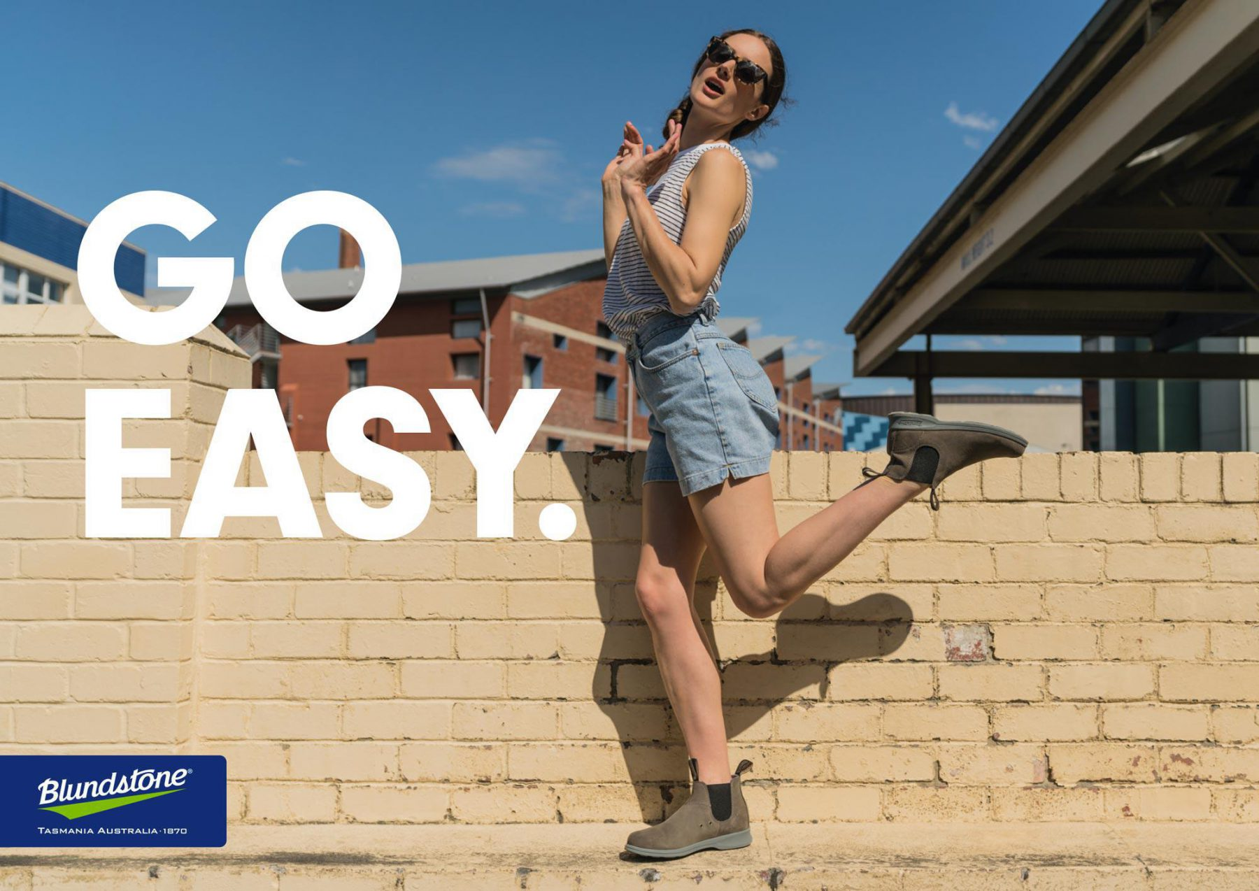 Poster with girl wearing Blundstone Summer Boots and text: Go Easy
