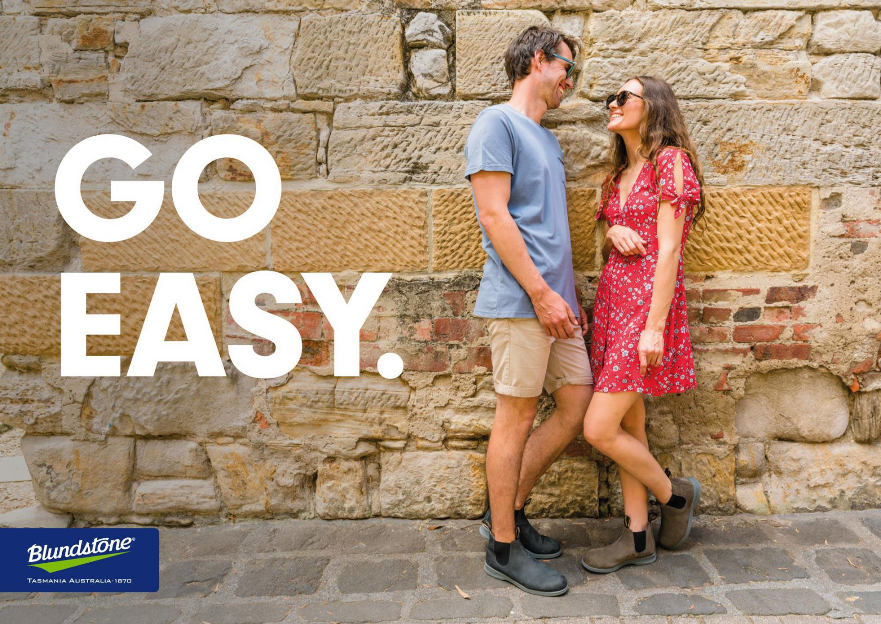 Poster with man and woman wearing Blundstone Summer Boots and text: Go Easy